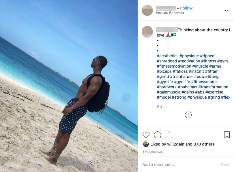 A man stands shirtless on the beach in the Bahamas and gazes out over the beach. Source: Instagram