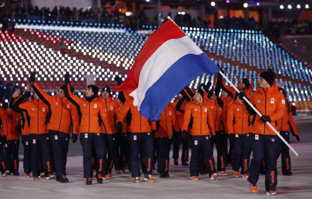 <p>Jan Smeekens carries the flag of the Netherlands during the opening ceremony of the 2018 Winter Olympics in Pyeongchang, South Korea, Friday, Feb. 9, 2018. (AP Photo/Jae C. Hong) </p>