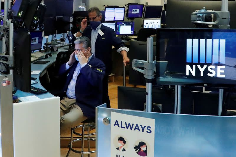 Wall Street ends lower on COVID-19 worries, tech weighs
