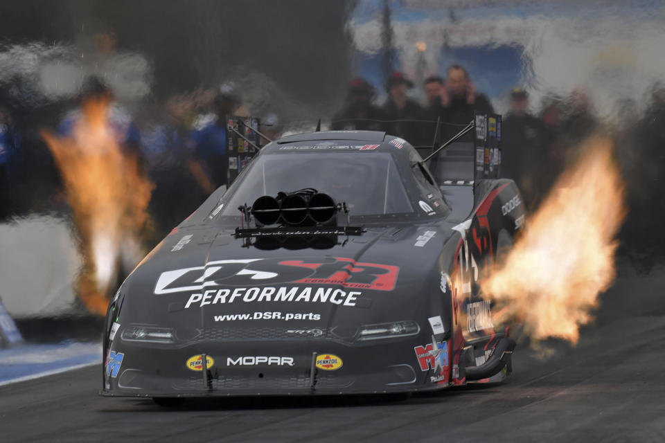 In this photo provided by the NHRA, Matt Hagan drives in Funny Car qualifying Friday, June 11, 2021, at the TascaParts.com NHRA New England Nationals drag races in Epping, N.H. (Auto Imagery/NHRA via AP)
