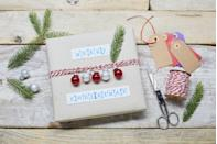 """<p>If you don't have festive wrapping paper on hand, use a kraft grocery store bag, then embellish with holiday accents, like jingle bells strung on baker's twine. </p><p><a class=""""link rapid-noclick-resp"""" href=""""https://www.amazon.com/Package-Miniature-Assorted-Holiday-Colored/dp/B00HG5KW0U?tag=syn-yahoo-20&ascsubtag=%5Bartid%7C10072.g.34015639%5Bsrc%7Cyahoo-us"""" rel=""""nofollow noopener"""" target=""""_blank"""" data-ylk=""""slk:SHOP JINGLE BELLS"""">SHOP JINGLE BELLS</a></p>"""