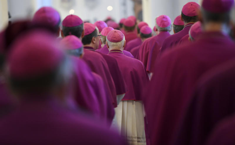 Bishops attend the opening mass of the German bishops' conference in Fulda, Germany, Tuesday, Sept. 25, 2018 where the bishops will discuss a study on sexual abuse in the Catholic church in Germany. (Arne Dedert/dpa via AP)