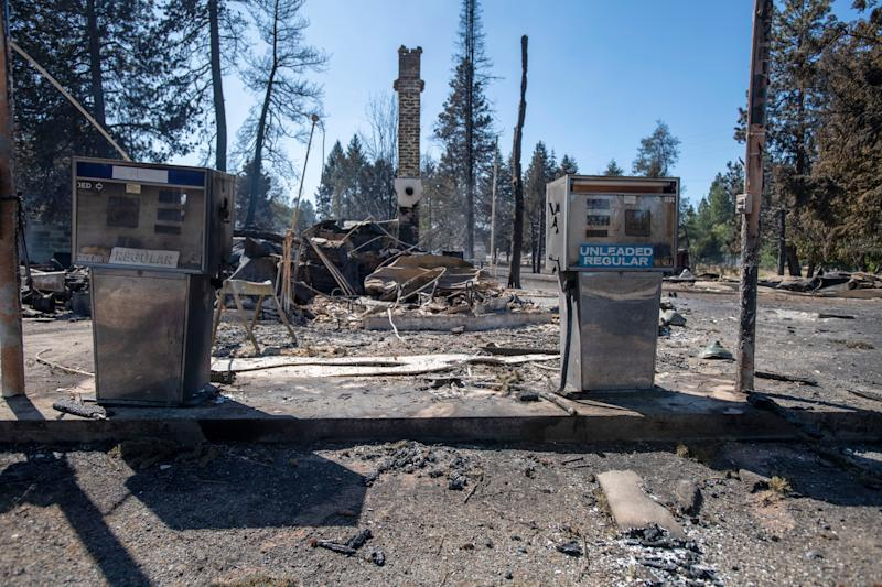A service station is destroyed Tuesday after Malden, Washington, is overrun by wildfire. High winds kicked up flames across the Pacific Northwest on Monday and Tuesday, burning hundreds of thousands of acres.  (Photo: Jed Conklin/ASSOCIATED PRESS)