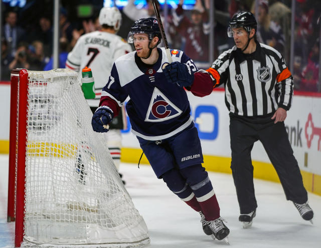 Colorado Avalanche left wing J.T. Compher (37) celebrates a Colin Wilson goal against the Chicago Blackhawks during the second period of an NHL hockey game, Saturday, March 23, 2019 in Denver. (AP Photo/Jack Dempsey)
