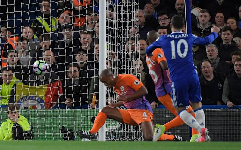 Chelsea's Eden Hazard scores their first goal after a deflection by Manchester City's Vincent Kompany - Credit: REUTERS