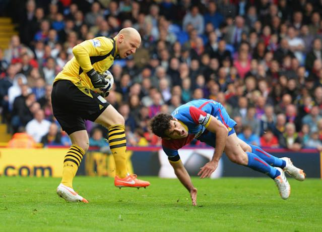 LONDON, ENGLAND - APRIL 12: Brad Guzan of Aston Villa clashes with Mile Jedinak of Crystal Palace during the Barclays Premier League match between Crystal Palace and Aston Villa at Selhurst Park on April 12, 2014 in London, England. (Photo by Christopher Lee/Getty Images)