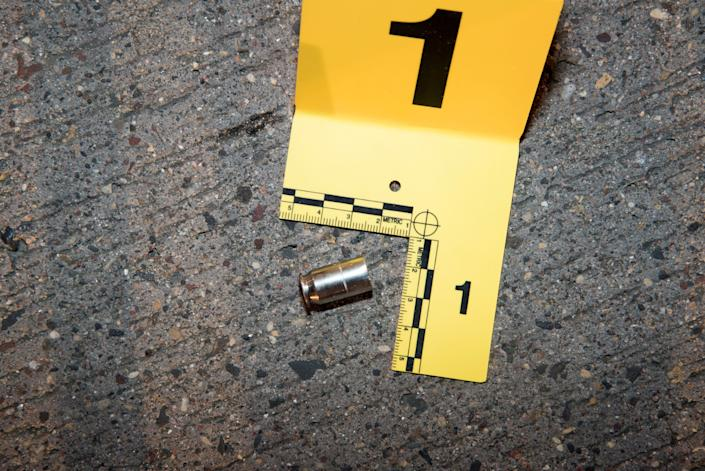 A shell casing from a bullet fired at Philando Castile lies outside his car.