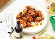 """Baked and...crispy? These ginger-soy glazed wings sound oxymoronic, until you try them. <a href=""""https://www.bonappetit.com/recipe/crispy-baked-chicken-wings?mbid=synd_yahoo_rss"""" rel=""""nofollow noopener"""" target=""""_blank"""" data-ylk=""""slk:See recipe."""" class=""""link rapid-noclick-resp"""">See recipe.</a>"""