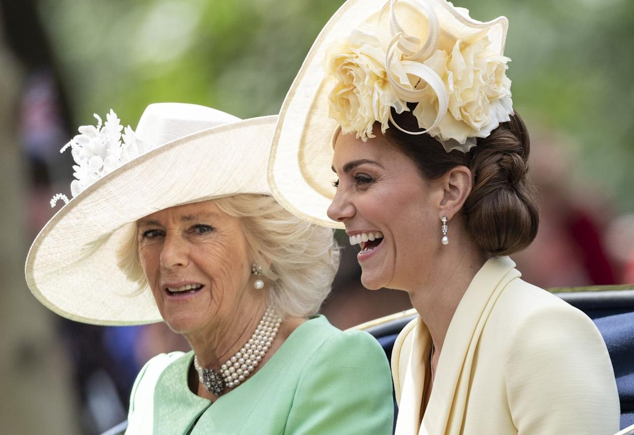 "<p>The Duchesses share a laugh during the <a href=""https://www.townandcountrymag.com/society/tradition/a10016954/trooping-the-colour-facts/"" target=""_blank"">Trooping the Colour</a> carriage procession.<br></p>"