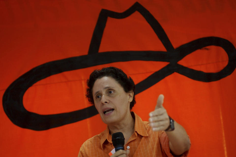 FILE - In this Aug. 21, 2005 file photo, Former Sandinista revolutionary commander Dora Maria Tellez, president of the Sandinista Renewal Movement or MRS, speaks during the party meeting to announce former Managua Mayor Herty Lewites as its presidential candidate for 2006 elections in Managua, Nicaragua. Nicaraguan police arrested Tellez, a prominent ex-Sandinista dissident on Sunday, June 13, 2021, bringing to six the number detained over the weekend, the biggest one-day roundup so far in President Daniel Ortega's campaign to jail anyone who might challenge his rule. (AP Photo/Ariel Leon, File)