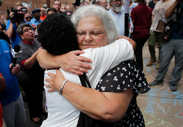 "<p>Susan Bro (R), mother of Heather Heyer, hugs a young woman near a makeshift memorial for her daughter Heather who was killed one year ago during a deadly clash, August 12, 2018 in Charlottesville, Virginia. Charlottesville has been declared in a state of emergency by Virginia Gov. Ralph Northam as the city braces for the one year anniversary of the deadly clash between white supremacist forces and counter protesters over the potential removal of Confederate statues of Robert E. Lee and Jackson. A ""Unite the Right"" rally featuring some of the same groups is planned for today in Washington, DC. (Photo: Win McNamee/Getty Images) </p>"