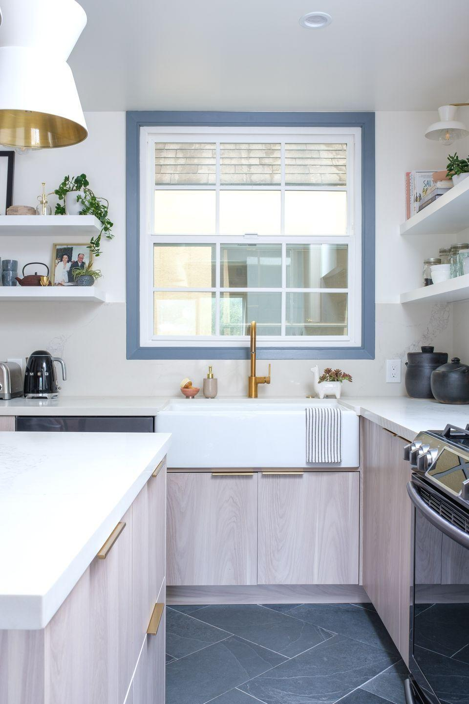 "<p>A wide blue border gives the main window in this San Francisco kitchen by <a href=""https://ginarachelledesign.com/"" rel=""nofollow noopener"" target=""_blank"" data-ylk=""slk:Gina Rachelle Design"" class=""link rapid-noclick-resp"">Gina Rachelle Design</a> a distinctive look. The IKEA cabinetry is paired with open shelving and cabinet fronts from the beloved brand <a href=""https://www.semihandmade.com/"" rel=""nofollow noopener"" target=""_blank"" data-ylk=""slk:Semihandmade"" class=""link rapid-noclick-resp"">Semihandmade</a>. </p>"