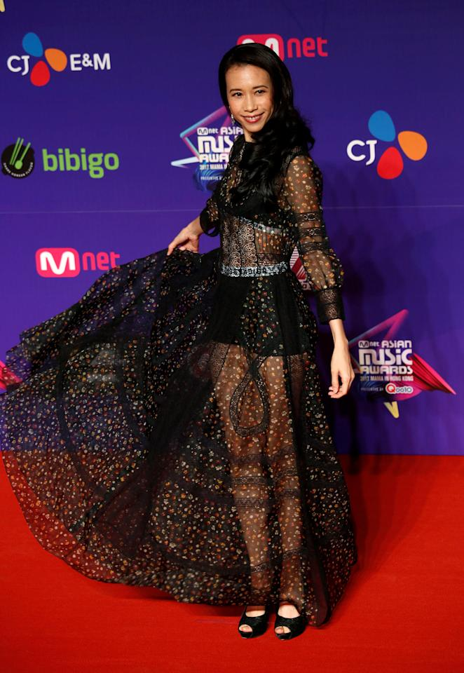 <p>Hong Kong actor Karen Mok poses on the red carpet during the Mnet Asian Music Awards in Hong Kong, China December 1, 2017. REUTERS/Bobby Yip </p>