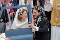 <p><em>Games of Thrones </em>costars, Rose Leslie and Kit Harington, smile as guests throw flower petals at them after their ceremony in Aberdeen, Scotland in 2018.  </p>