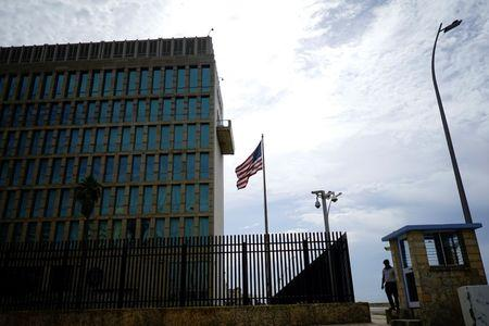 A security officer stands next to the U.S. Embassy in Havana