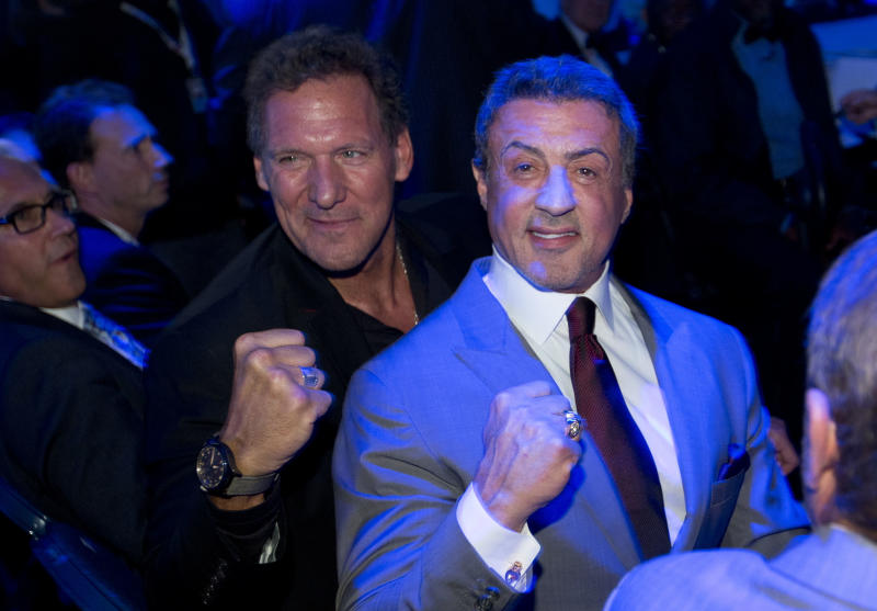 U.S. actor Sylvester Stallone, right, and German actor Ralf Moeller, left, attend the WBA, IBF and WBO heavyweight boxing world champion bout between Wladimir Klitschko of the Ukraine and Mariusz Wach of Poland in Hamburg, Germany, Saturday, Nov. 10, 2012. (AP Photo/Gero Breloer)
