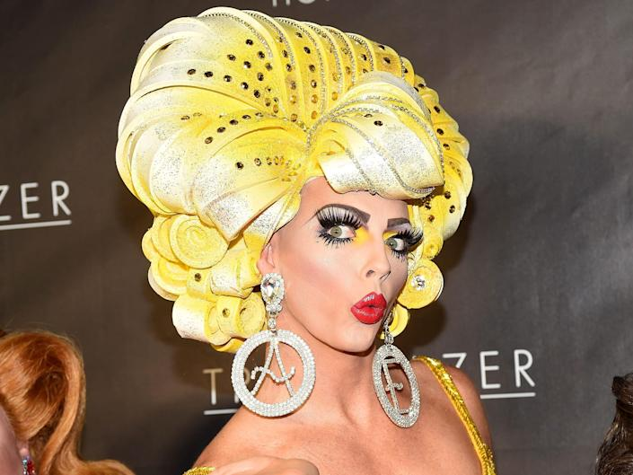 Alyssa Edwards with a blonde wig and red lips