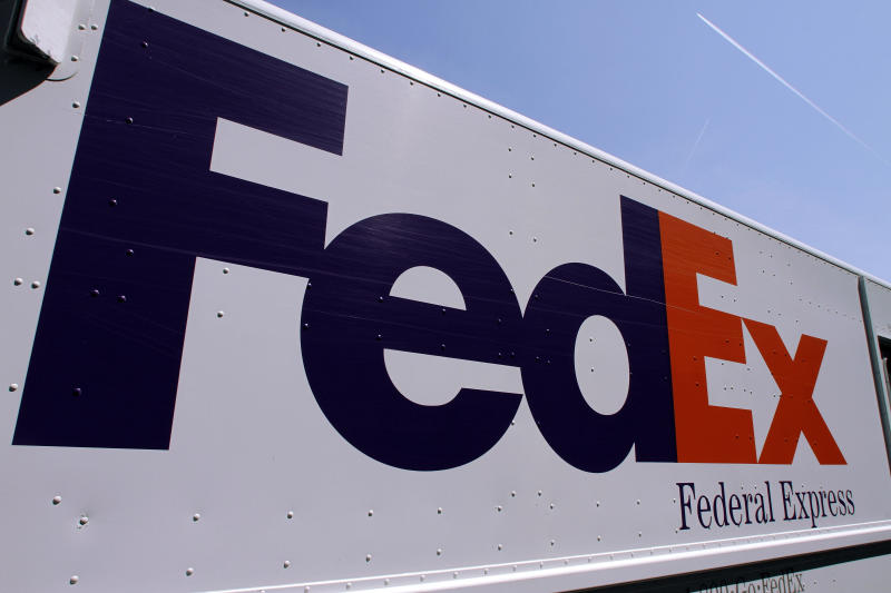 FILE-In this Wednesday, May 16, 2012, file photo, a FedEx delivery truck is seen at the Illinois State Capitol in Springfield, Ill. FedEx Corp. says the global economy is worsening and it's cutting its forecast for the fiscal year ending in May. The world's second largest package delivery company says profit in the current quarter will be well below year ago results. (AP Photo/Seth Perlman, File)