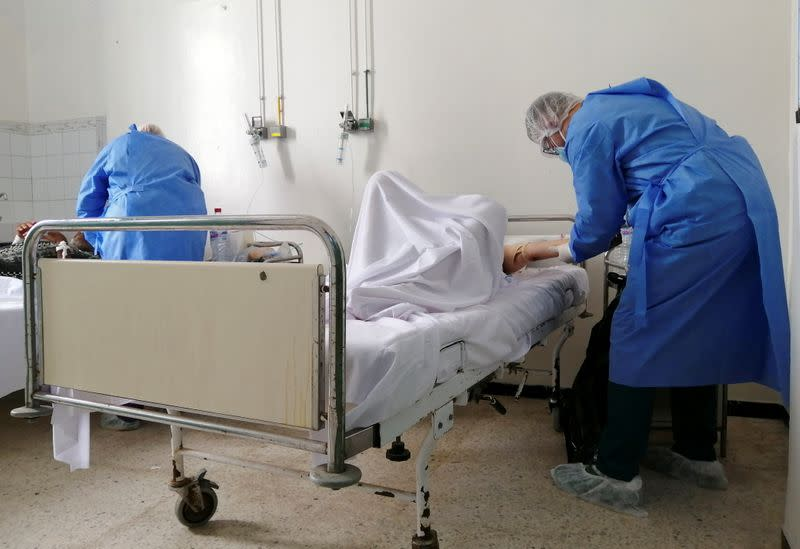 Medical staff assist COVID-19 patients at Charles Nicole Hospital in Tunis