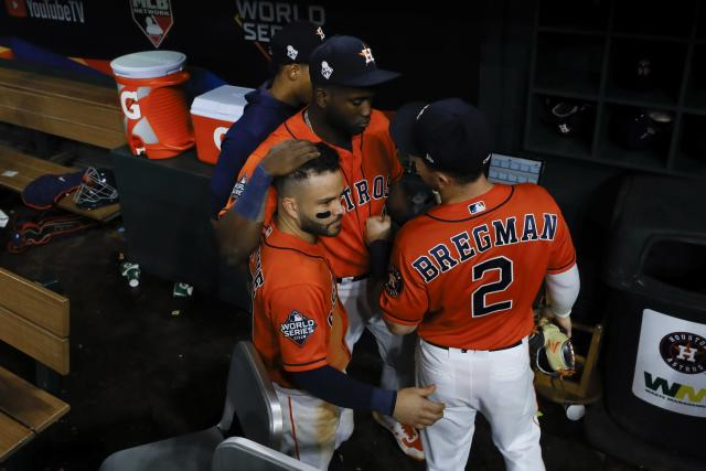 Houston Astros' Yordan Alvarez, Alex Bregman and Jose Altuve huddle after Game 7 of the baseball World Series against the Washington Nationals Wednesday, Oct. 30, 2019, in Houston. The Nationals won 6-2 to win the series. (AP Photo/Matt Slocum)