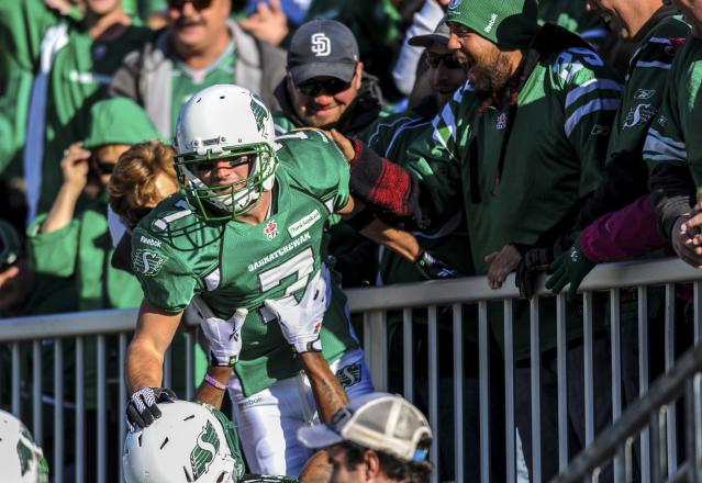 Saskatchewan Roughriders slotback Weston Dressler celebrates with the crowd after scoring a touchdown during the first half of their CFL football game against the Edmonton Eskimos in Regina, Saskatchewan October 12, 2013. REUTERS/Matt Smith (CANADA - Tags: SPORT FOOTBALL)