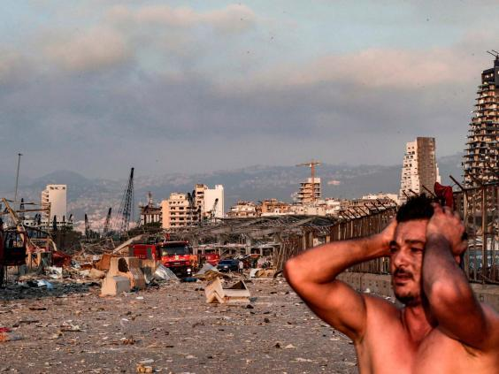 A man reacts at the scene of an explosion at the port in Lebanon's capital Beirut (AFP via Getty Images)