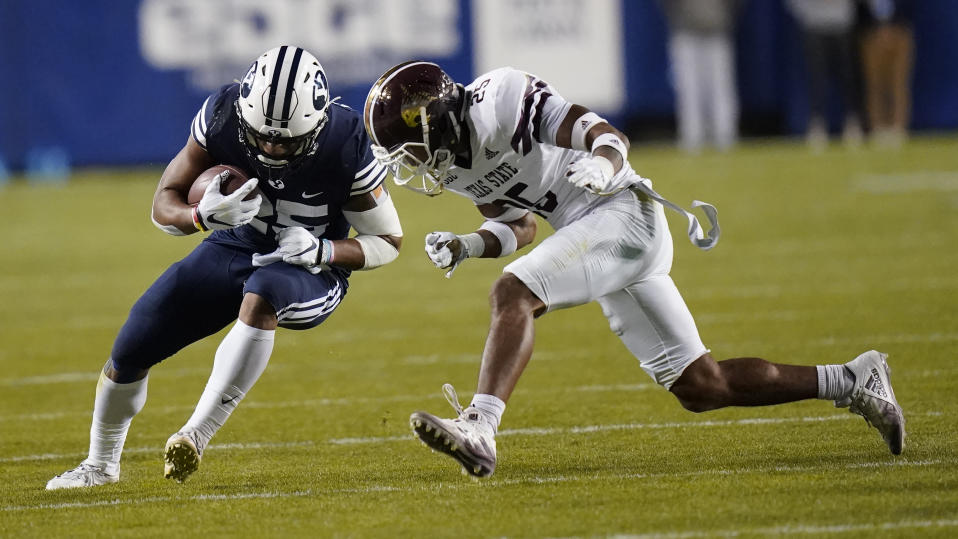 Texas State safety Brendon Luper, right, tackles BYU running back Tyler Allgeier, left, in the first half during an NCAA college football game Saturday, Oct. 24, 2020, in Provo, Utah. (AP Photo/Rick Bowmer)