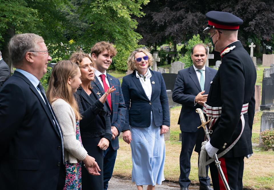 The family were joined by armed forces and charity representatives (PA Wire)