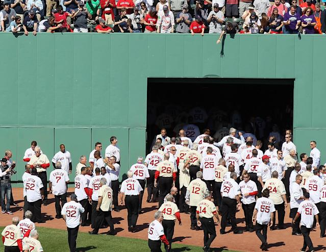 BOSTON, MA - APRIL 20: Former Boston Red Sox players, coaches and managers leave the field after a ceremony before the game between the New York Yankees and the Boston Red Sox on April 20, 2012 at Fenway Park in Boston, Massachusetts. Today marks the 100 year anniversary of the ball park's opening. (Photo by Elsa/Getty Images)