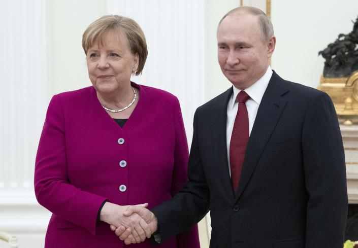 Russian President Vladimir Putin, right, and German Chancellor Angela Merkel pose for a photo prior to the talks in the Kremlin in Moscow, Russia, Saturday, Jan. 11, 2020. Merkel visits Moscow to discuss current international issues such as the situation in Syria, Libya, Ukraine, US-Iran tensions, as well as bilateral relations. (AP Photo/Pavel Golovkin)