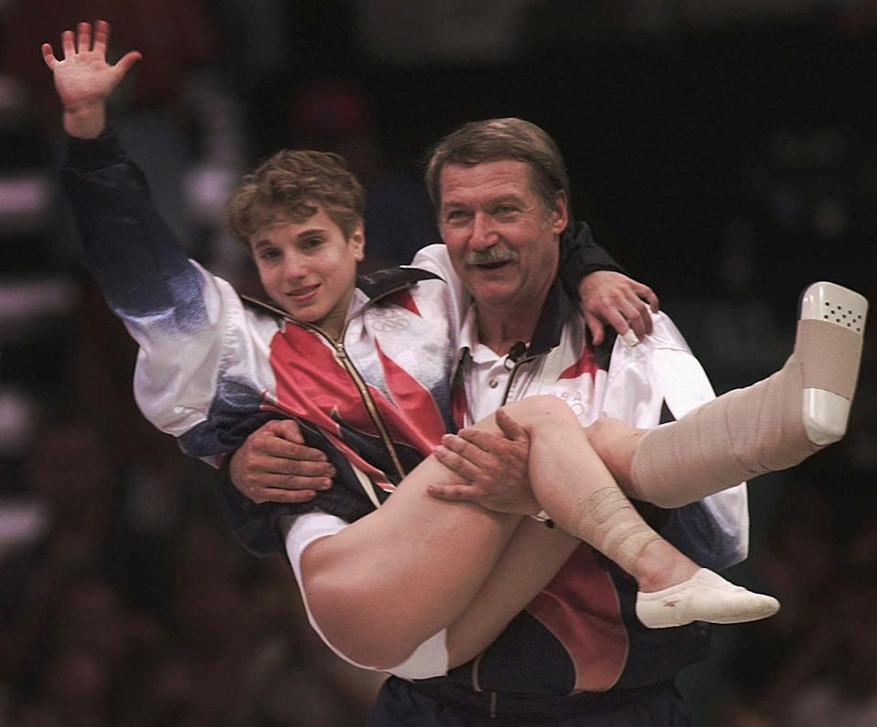 Although the last vault for Kerri Strug was unnecessary for a win, the U.S. gymnast was unaware of the technicality and went ahead for the final performance, with a sprained ankle. Limping onto the floor and cheered on by the crowd, Strug sprang into action and landed holding up her hurt foot and waving to the judges with a 9.712 score. (AP Photo/Susan Ragan)
