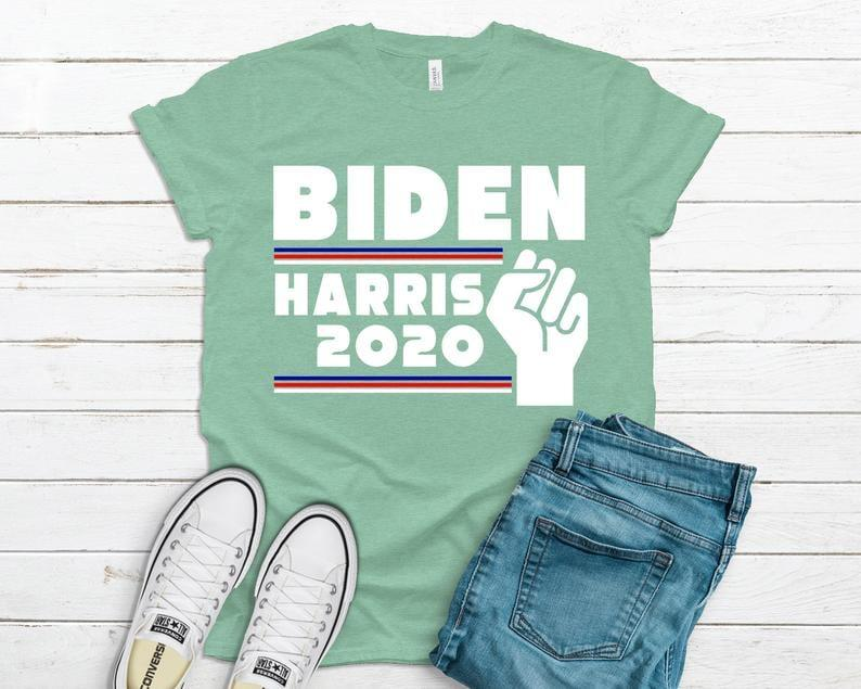 "<p><product href=""https://www.etsy.com/listing/839527234/biden-harris-2020-shirt-biden-harris?ga_order=most_relevant&amp;ga_search_type=all&amp;ga_view_type=gallery&amp;ga_search_query=joe+biden&amp;ref=sr_gallery-1-40&amp;organic_search_click=1&amp;pro=1"" target=""_blank"" class=""ga-track"" data-ga-category=""internal click"" data-ga-label=""https://www.etsy.com/listing/839527234/biden-harris-2020-shirt-biden-harris?ga_order=most_relevant&amp;ga_search_type=all&amp;ga_view_type=gallery&amp;ga_search_query=joe+biden&amp;ref=sr_gallery-1-40&amp;organic_search_click=1&amp;pro=1"" data-ga-action=""body text link"">Biden Harris 2020 Shirt </product> ($16)</p>"