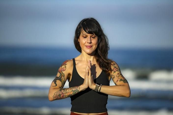 Carlsbad, CA - June 11: A yoga teacher Laura Schwartz in Carlsbad who closed her yoga studio after her business partner embraced conspiracy theories. Schwartz was photographed at beach on Friday, June 11, 2021 in Carlsbad, CA. (Irfan Khan / Los Angeles Times)