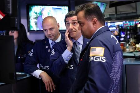 Stocks mostly flat ahead of G20; dollar slips