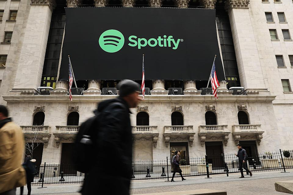 NEW YORK, NY - APRIL 03: The Spotify banner hangs from the New York Stock Exchange (NYSE) on the morning that the music streaming service begins trading shares at the NYSE on April 3, 2018 in New York City. Trading under the symbol SPOT, the Swedish company's losses grew to 1.235 billion euros ($1.507 billion) last year, its largest ever. (Photo by Spencer Platt/Getty Images)