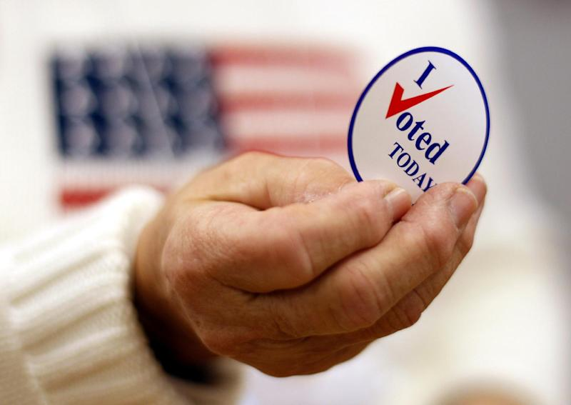 FILE - This Nov. 2, 2010 file photo shows a sticker handed out to a voter on Election Day, in Waterville, Maine.  Here's something most politicians can click the like button for: Facebook friends played a big role in getting hundreds of thousands of people to vote in 2010 who probably would have otherwise stayed home, a new scientific study claims. It provides scientific evidence showing the real world political power of social media. (AP Photo/Robert F. Bukaty, File)