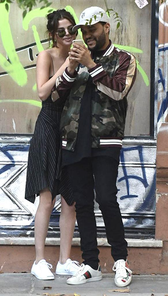 "<p>This year, Selena accompanied the Weeknd on tour all around the world, and they made sure to make time for themselves. Here, the couple can be seen goofing around and shopping in Buenos Aires, Argentina. Taylor Swift's bestie has said that she <a href=""https://www.yahoo.com/celebrity/selena-gomez-talks-relationship-weeknd-says-havent-feeling-191813066.html"" data-ylk=""slk:loves supporting her boyfriend on the road"" class=""link rapid-noclick-resp"">loves supporting her boyfriend on the road</a>. ""I love just being there and just kind of having somebody's back,"" she explained in an interview with SiriusXM. ""It feels good. I haven't had that feeling in a while."" Selena added that she loves being able to watch from backstage, and just throw her ""hair in a bun"" and ""dance all night."" (Photo: The Grosby Group/AKM-GSI) </p>"