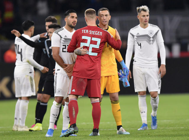 Germany's goalkeeper Marc-Andre Ter Stegen, left, hugs Argentina's goalkeeper Agustin Marchesin after the international friendly soccer match between Germany and Argentina at the Signal Iduna Park stadium in Dortmund, Germany, Wednesday, Oct. 9, 2019. (AP Photo/Martin Meissner)