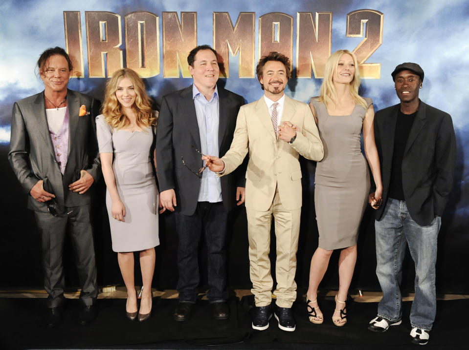 (L-R) Cast members Mickey Rourke, Scarlett Johansson, director Jon Favreau, Robert Downey Jr, Gwyneth Paltrow and Don Cheadle pose during a photocall for the movie Iron Man 2 in Los Angeles, California April 23, 2010. REUTERS/Gus Ruelas (UNITED STATES - Tags: ENTERTAINMENT PROFILE)
