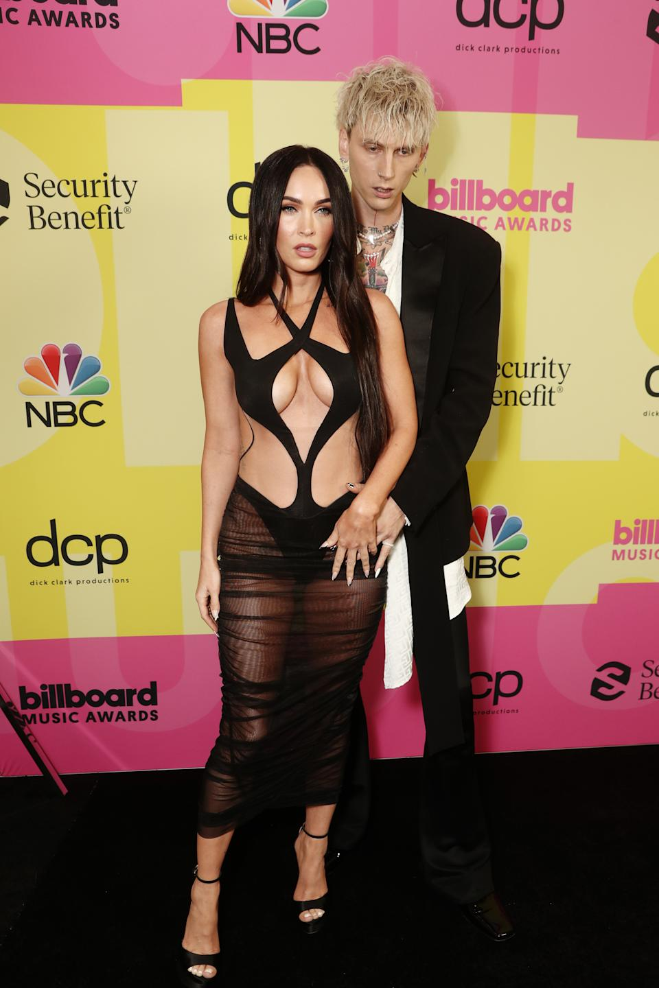 LOS ANGELES, CA - MAY 23: 2021 BILLBOARD MUSIC AWARDS -- Pictured: (l-r) Megan Fox and Machine Gun Kelly arrive to the 2021 Billboard Music Awards held at the Microsoft Theater on May 23, 2021 in Los Angeles, California. -- (Photo by Todd Williamson/NBC/NBCU Photo Bank via Getty Images)