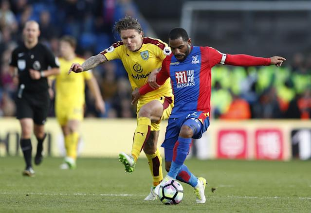 <p>Crystal Palace's Jason Puncheon in action with Burnley's Jeff Hendrick </p>