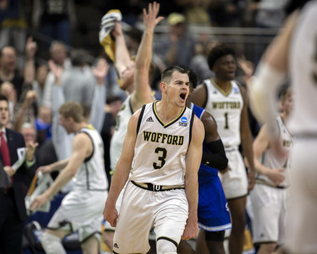 Wofford guard Fletcher Magee (3) celebrates with teammates after hitting a 3-point basket during the final moments of the second half against Seton Hall in a first-round game in the NCAA mens college basketball tournament in Jacksonville, Fla. Thursday, March 21, 2019. (AP Photo/Stephen B. Morton)