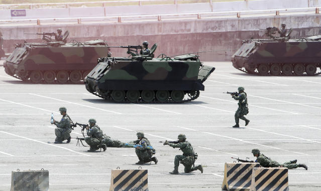 Taiwan military personnel maneuver during an exercise at a port in Hualien County, eastern of Taiwan, Wednesday, May 22, 2019. (AP Photo/Chiang Ying-ying)