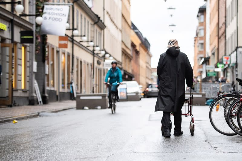Woman strolls through the Sodermalm area of Stockholm