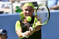 Sharapova battles on while Kyrgios crashes out at US Open
