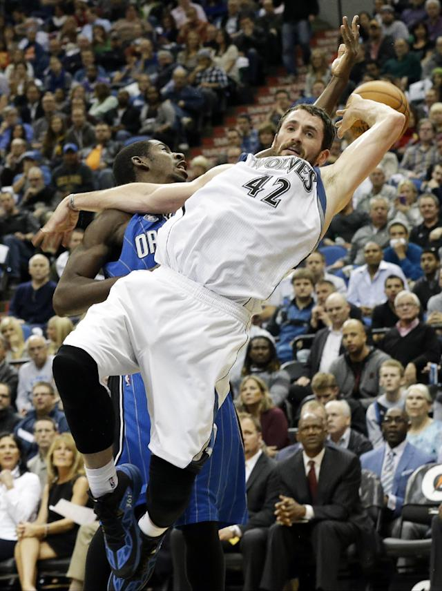 Minnesota Timberwolves' Kevin Love, right, falls and Orlando Magic's Andrew Nicholson loses the ball as they collide in the second half of an NBA basketball game, Wednesday, Oct. 30, 2013, in Minneapolis. Love led the Timberwolves with 31 points and 17 rebounds in their 120-115 win in overtime. (AP Photo/Jim Mone)