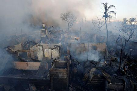 Destroyed houses are seen during a fire at a residential neighbourhood in Las Pinas, Metro Manila, Philippines, March 14, 2018. REUTERS/Erik De Castro