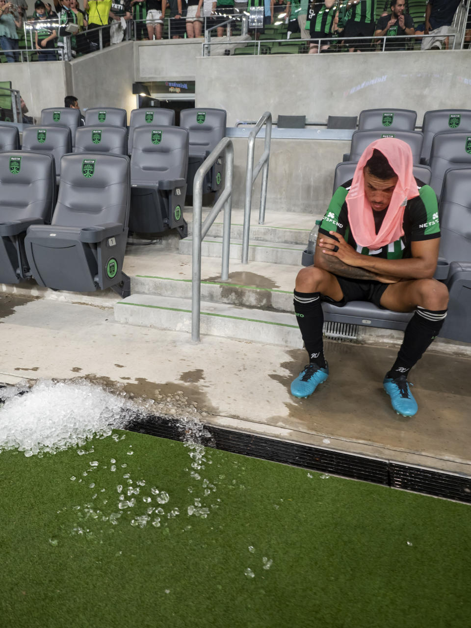 Austin FC defender Julio Cascante sits on the bench after the team's loss to the San Jose Earthquakes in an MLS soccer match Saturday, Sept. 18, 2021, in Austin, Texas. The Earthquakes won 4-3. (AP Photo/Michael Thomas)