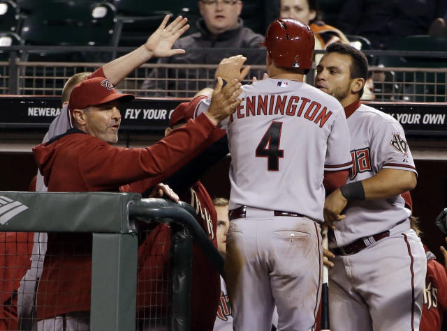 Arizona Diamondbacks' Cliff Pennington (4) is greeted in the dugout after scoring on a single from Tony Campana during the 10th inning of a baseball game on Thursday, April 10, 2014, in San Francisco. Arizona won 6-5. (AP Photo/Marcio Jose Sanchez)