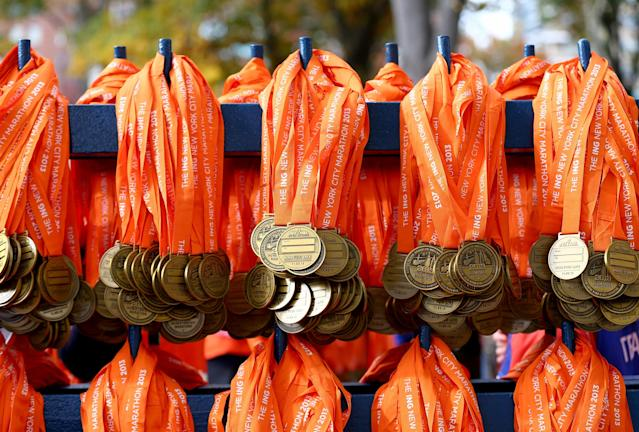 NEW YORK, NY - NOVEMBER 03: Medals are distributed for participants beyond the finish line of the the 2013 ING New York City Marathon on November 3, 2013 in New York City. (Photo by Elsa/Getty Images)